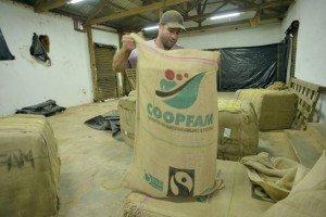 Audrei Cavalho Suarez is rearranging coffee bags.