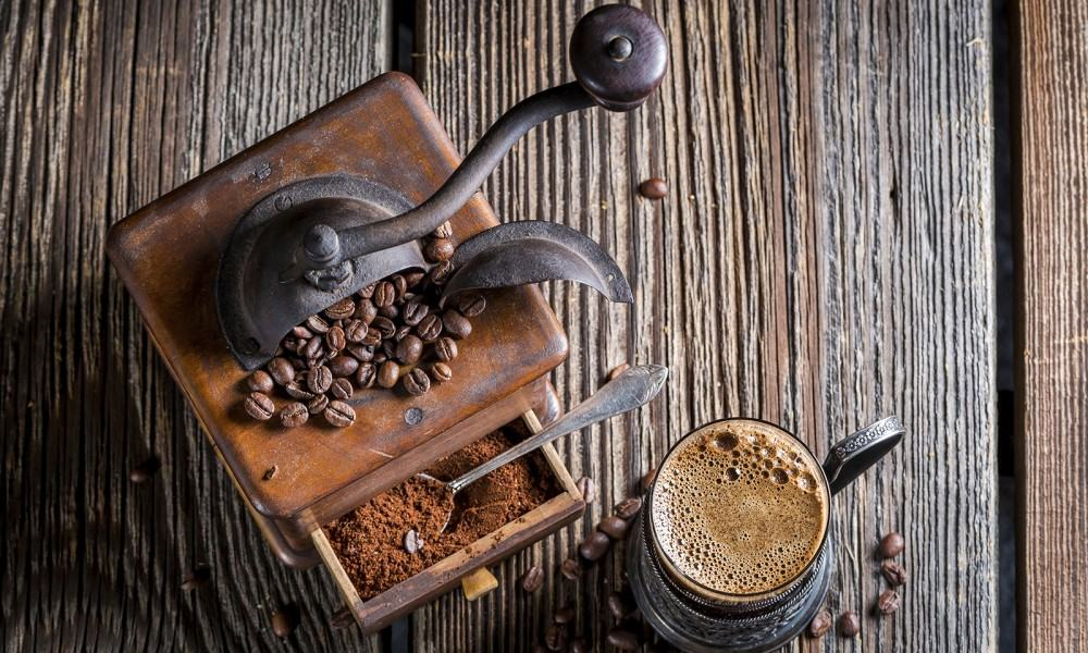 Fresh ground coffee and old grinder