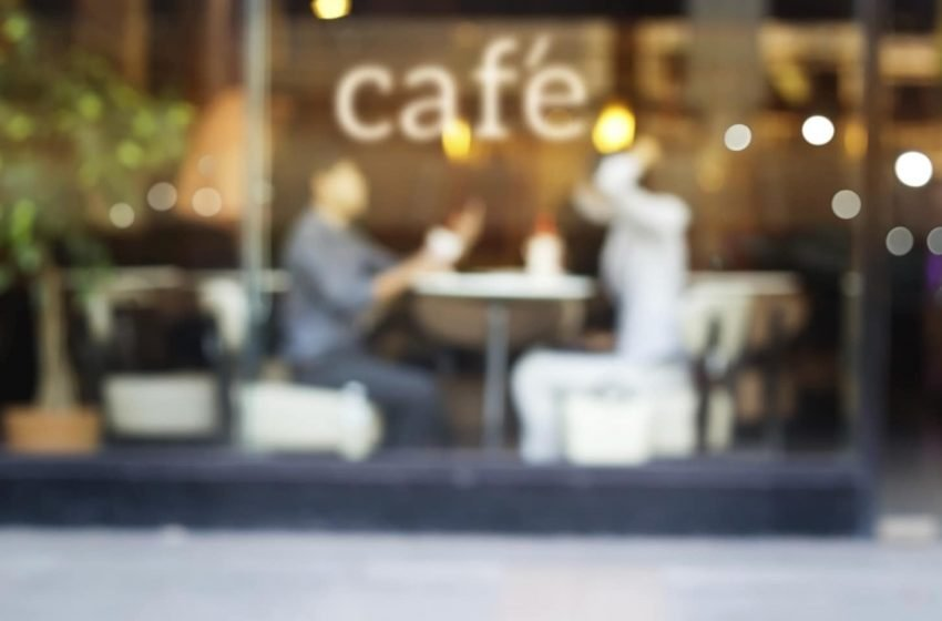 Abstract people in coffee shop and text cafe in front of mirror,