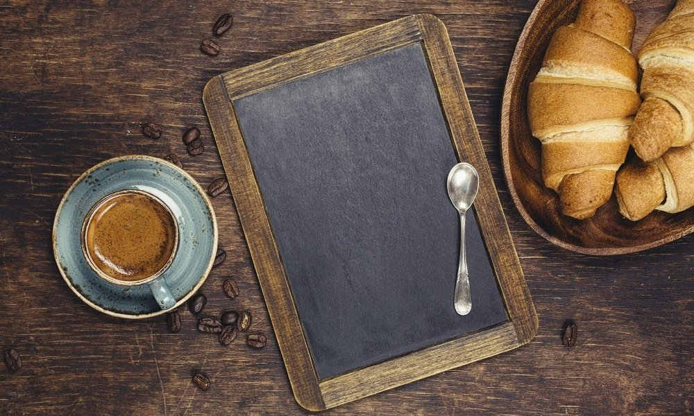 Croissants and coffee with blackboard
