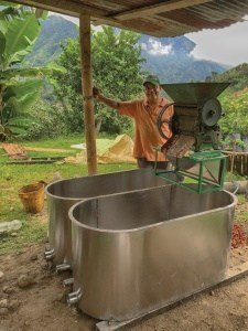 Oscar Morales Ospina stands beside his new coffee washing tub.